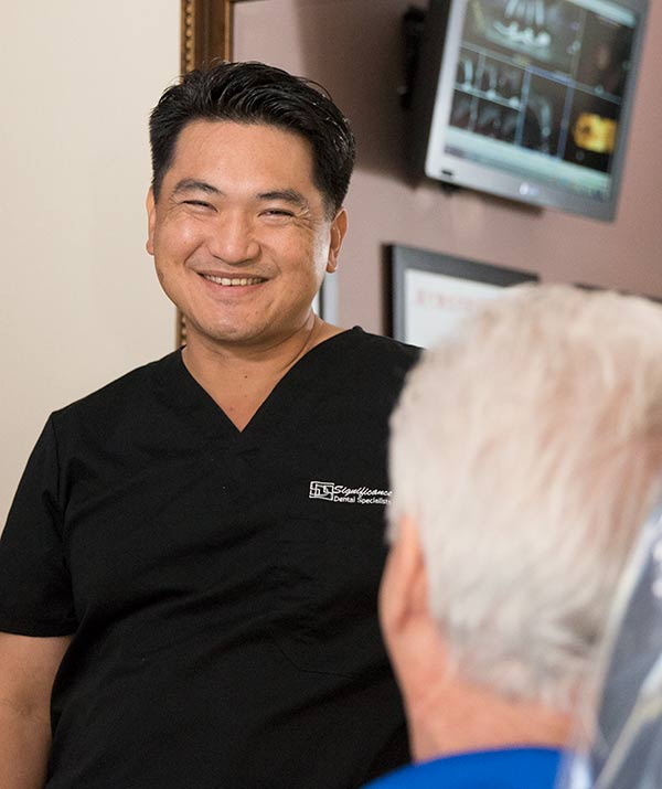 Dr Huang smiles at patient - Las Vegas, NV