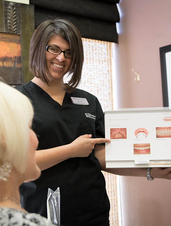 Significance Dental Assistant shows dental illustrations - Las Vegas, NV