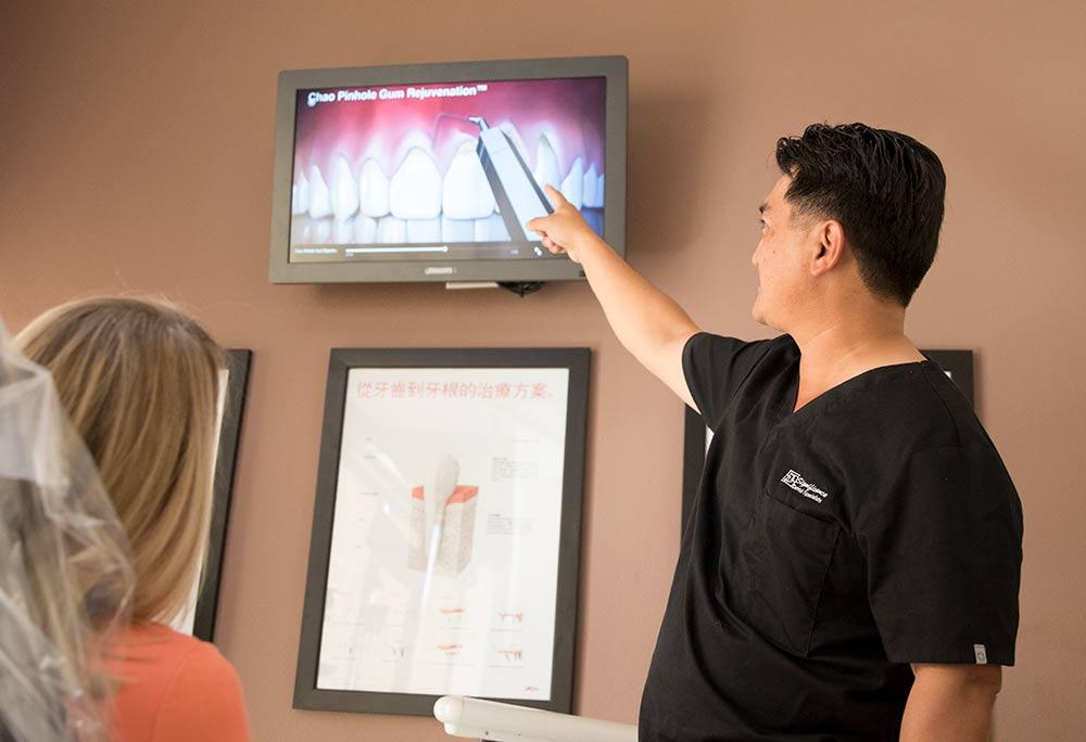 Dr. Huang shows pinhole technique to patient - Las Vegas, NV